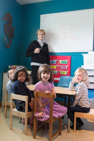 Children at table with teacher